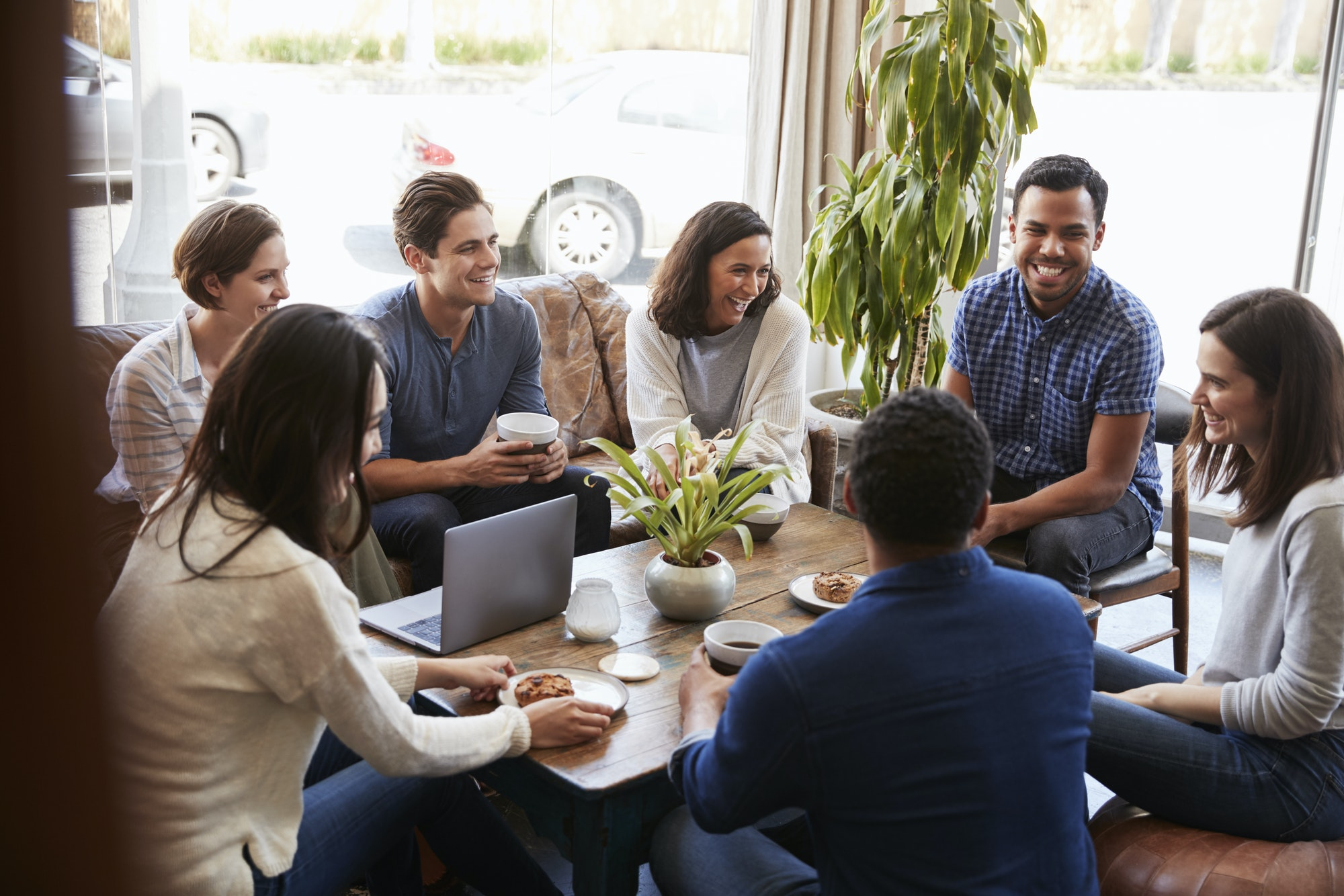 Group of friends having coffee together at a coffee shop